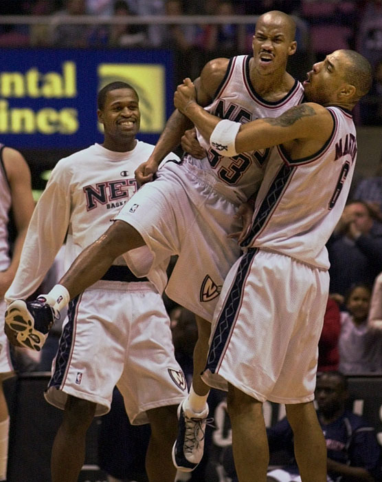 Kenyon Martin lifts up Stephon Marbury as Stephen Jackson looks on after Marbury scored the game-winning basket to beat the 76ers.