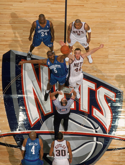 Keith Van Horn and Elden Campbell tip off to begin a 2001 game against the Hornets.