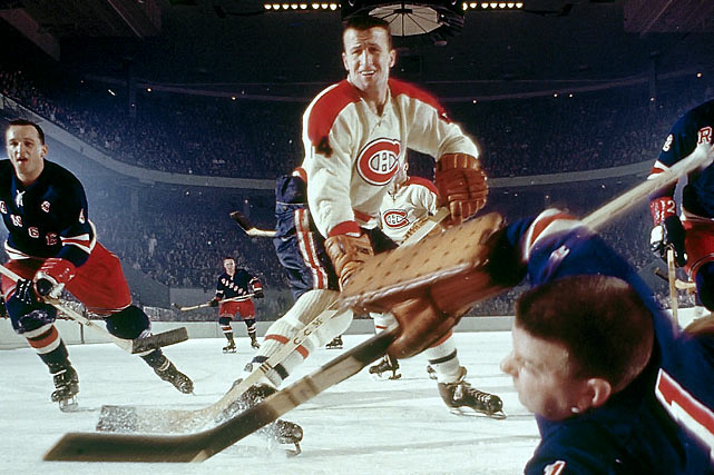The hustling, hard-checking right winger whose job was to shadow the opposing team's stars, spent his entire NHL career with the Canadiens, winning championships in 1956-60, '65,'66, '68 and '69.