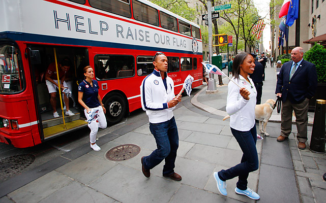 2008 Olympic gold medalists Bryan Clay (center) and Allyson Felix (right) were part of a U.S. contingent that invaded Times Square on April 18, celebrating 100 days out from the London Games.