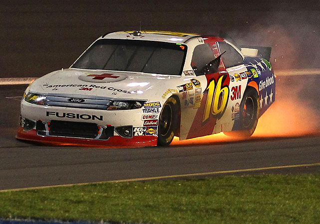 Greg Biffle blows the engine of the #16 3M/American Red Cross Ford on lap 68. There are flames trailing the car, but he's able to get out of it uninjured.