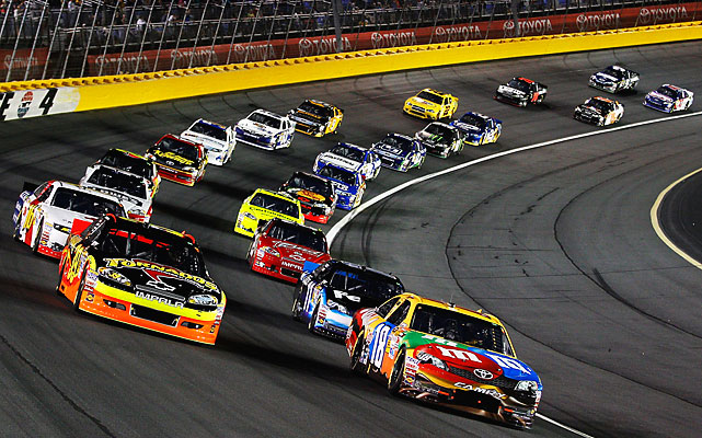 Pole-sitter Kyle Busch, driver of the #18 M&M's Toyota, leads the field to the start of the race.