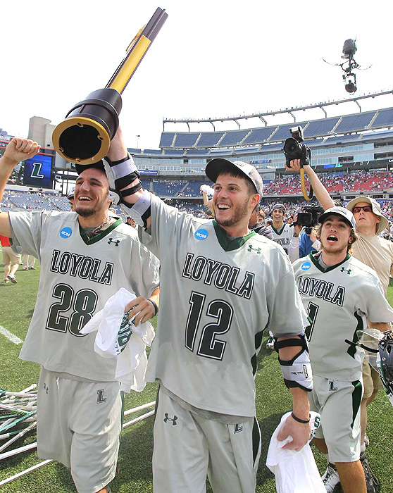 After scoring four goals, more than the total Maryland team combined, Eric Lusby hoists the trophy over his head.