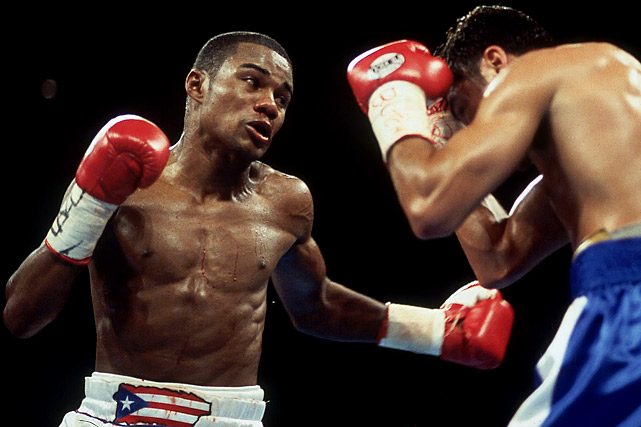 """""""Tito,"""" who holds the record for welterweight title defenses (15), also won belts at junior middleweight and middleweight. Knocked down seven times in fights he ultimately won by knockout, Trinidad's indomitable fighting spirit made him one of the island nation's most beloved champions."""
