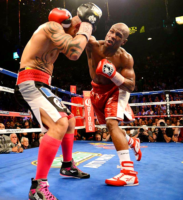 Floyd Mayweather took away Miguel Cotto's 154-pound title with a unanimous decision Saturday night in Las Vegas.