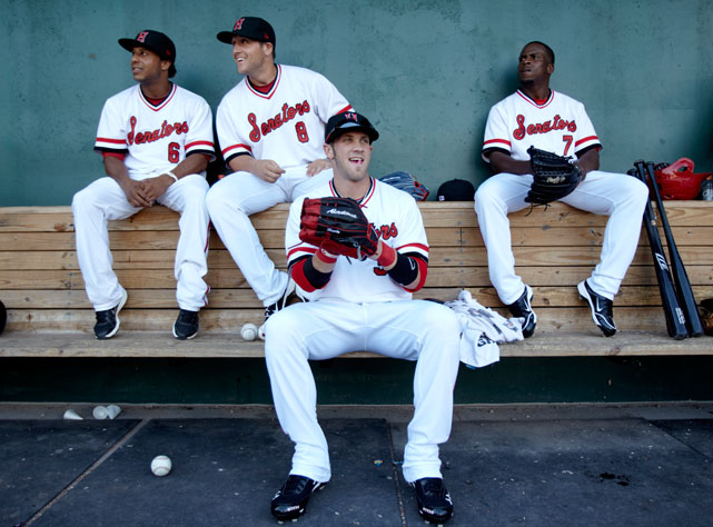 Harper (34) hangs out in the dugout with Senators teammates Jonathan Tucker (6), Archie Gilbert (7) and Adam Fox (8) before a July 2011 game against Akron.