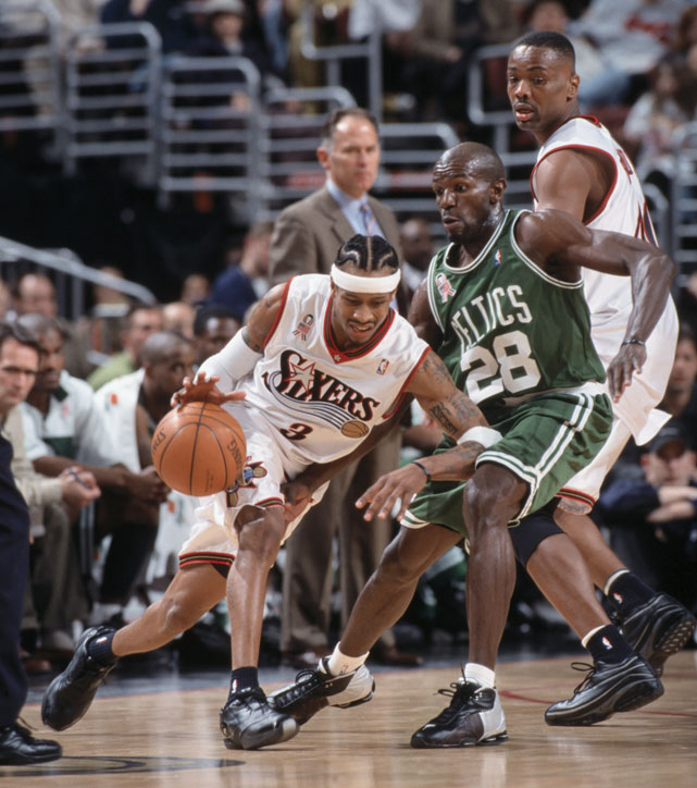 Allen Iverson dribbles around Tony Delk during a March 2002 regular season NBA game at the First Union Center in Philadelphia. The 76ers fell to the Celtics 100-94.