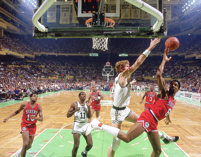 During a 1985 preseason game, Bill Walton blocks a shot attempt by Julius Erving.  Walton would go on to average 7.6 points and 6.8 rebounds per game that season en route to an NBA Championship in 1986.