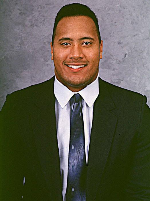 "Wednesday marks the 40th birthday of Dwayne ""The Rock"" Johnson. The WWE superstar got his start as a member of the 1991 Miami Hurricanes football team, where he won a 1991 national championship alongside Warren Sapp and Gino Torretta. After being cut by the Calgary Stampeders of the Canadian Football League, Johnson followed the path of his father and grandfather and became a professional wrestler. He quickly became one of the WWE's top attractions and soon transitioned to Hollywood, where he's starred in over a dozen movies. As Johnson celebrates the big 4-0, SI looks back at some rare photos of The Rock."