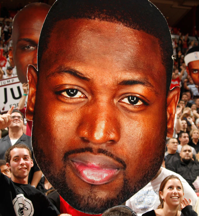 Heat fans hold a cutout of Dwyane Wade during a Jan. 2012 game against the Lakers.