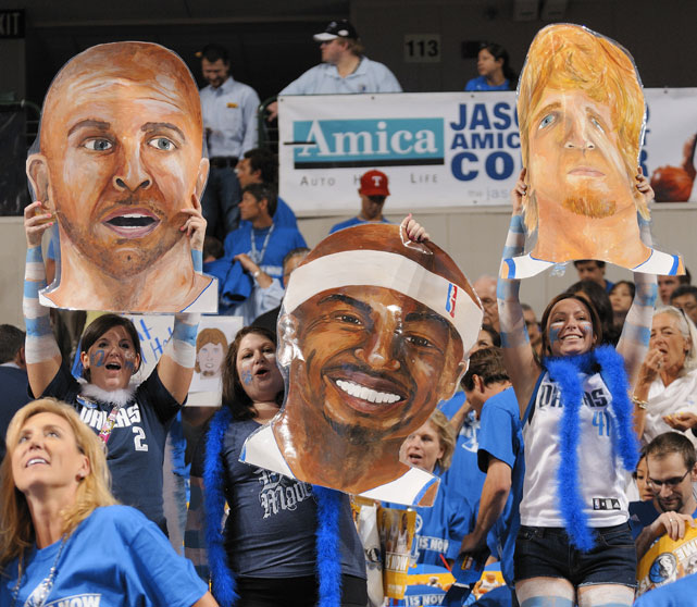 Dallas fans bring an illustrated cardboard cutout of Jason Kidd, Jason Terry and Dirk Nowitzki to a game against the Heat.