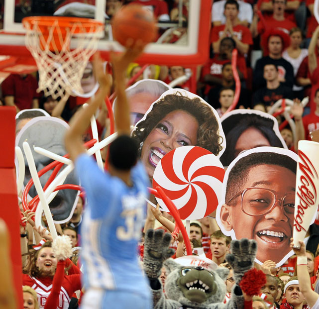 John Henson has to contend with the giant face of Urkel and Oprah Winfrey while attempting a free throw against NC State.