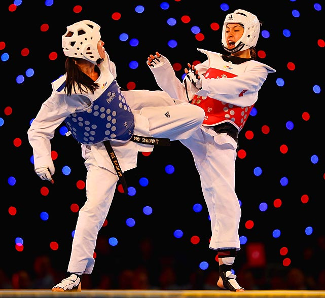 Hatice Kubra Yangin of Turkey spars Ana Zaninovic of Croatia in the 53kg Final during the European Taekwondo Championships in Manchester, England.