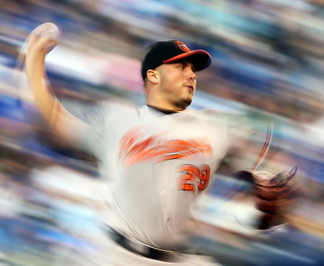Baltimore Orioles' starting pitcher Tommy Hunter throws against the Kansas City Royals.