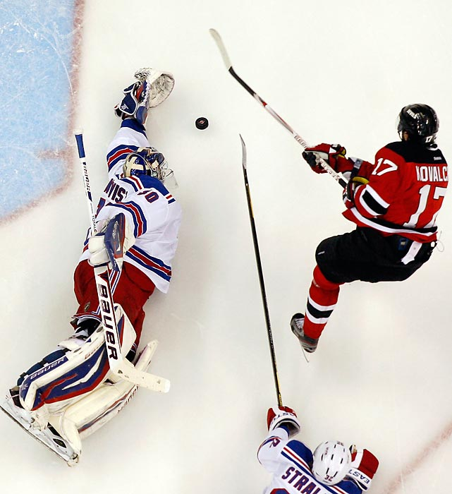 New York Rangers goaltender Henrik Lundqvist makes a beautiful sprawling save on a breakaway by New Jersey Devils' Ilya Kovalchuk in Game 3 of the Eastern Conference Finals. Lundqvist didn't allow any goals in the Rangers' 2-0 win.