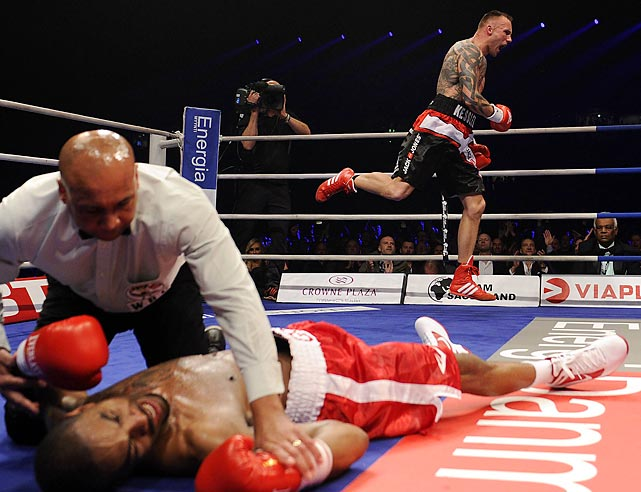 Allan Green was knocked down during a WBC Light Heavyweight title fight against Mikkel Kessler.