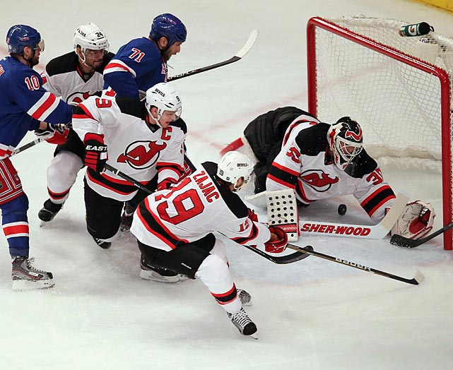 The puck gets under New Jersey Devils goalie Martin Brodeur during the Eastern Conference Final. No worries for Brodeur, however; the Devils would go on to win the game 3-2.