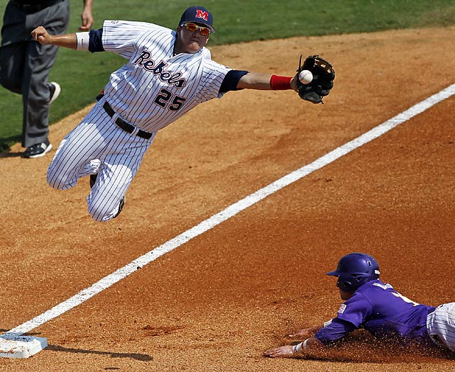 Mississippi third baseman Andrew Mistonea catches the high throw as LSU's Tyler Hanover slides safely into third on a steal during the SEC tournament.
