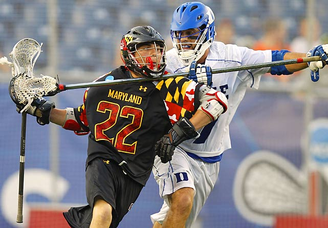 Duke's Michael Manley clotheslines Maryland's' Sean McGuire with his stick during their semifinal of the NCAA lacrosse championships.