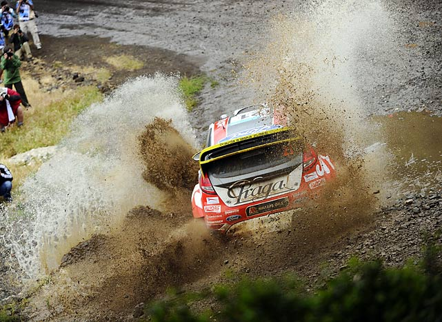 Martin Prokop of Czech plows his Ford Fiesta WRC through the muddy course during the shakedown of the Acropolis Rally in Corinth, Greece.