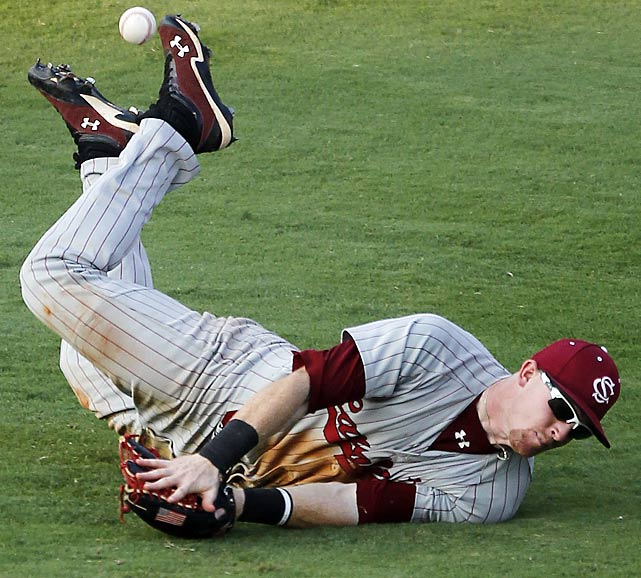 South Carolina's Adam Matthews cannot make the catch on a base hit by Auburn's Creede Simpson during the SEC tournament.