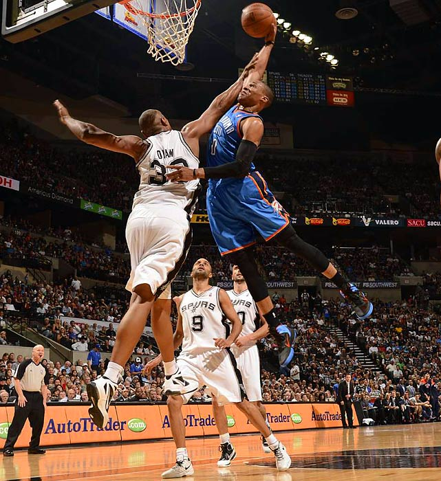 San Antonio Spurs' Boris Diaw tries to block Oklahoma City Thunder's Russell Westbrook's shot during Game 1 of the Western Conference Finals.