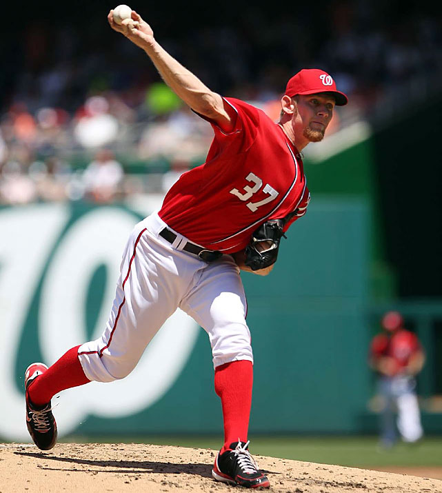 In addition to his 2-for-2 performance at the plate, Strasburg (4-1) struck out eight in five innings before being lifted by manager Davey Johnson, who said the pitcher mentioned tightness in his biceps.