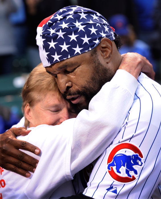 Mr. T hugs Linda Pahnke, whose son Shawn was killed in Iraq in 2003, before a Cubs-Pirates game at Wrigley Field.