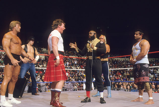 "By 1985, Mr. T was an international star and just what the WWF needed to promote its inaugural Wrestlemania card. In this photo, T confronts ""Rowdy"" Roddy Piper as Paul Orndorff, ""Cowboy"" Bob Orton, Hulk Hogan and ""Superfly"" Jimmy Snuka look on."