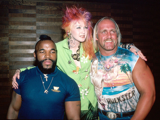 Cyndi Lauper poses with Mr. T and Hulk Hogan. Lauper would escort the two to the ring during Wrestlemania I from Madison Square Garden.
