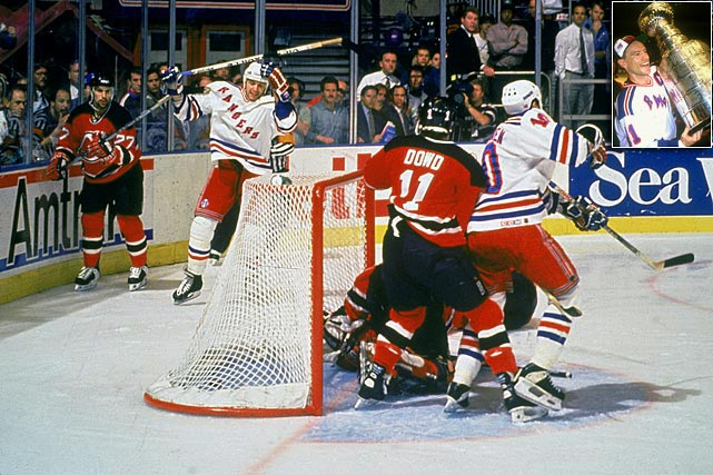 This epic seven-game series featured Mark Messier's guarantee of a series-tying victory by the Rangers in Game 6 (he scored a natural hat-trick in the third period) and the Game 7 goal scored by New York's Stephane Matteau that haunted Martin Brodeur for years. The Rangers went on to top the Vancouver Canucks in seven games and claim their first Stanley Cup Championship since 1940, ending an NHL-record 54-year championship drought.