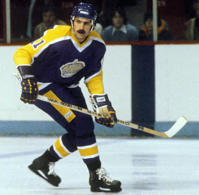 "Signed as a free agent in August 1977 after three seasons with the California Golden Seals/Cleveland Barons franchise, Charlie Simmer played eight seasons for Los Angeles from 1978-1985, twice earning All-Star nods.  During his tenure, he produced 222 goals and 244 assists for 466 total points in 384 games and was the left wing on the ""Triple Crown Line"" with Marcel Dionne and Dave Taylor. The high-point of his Kings career: back to back 56-goal seasons in 1979-80 and 1980-81. He ranks eighth on the Kings' all-time scoring list."