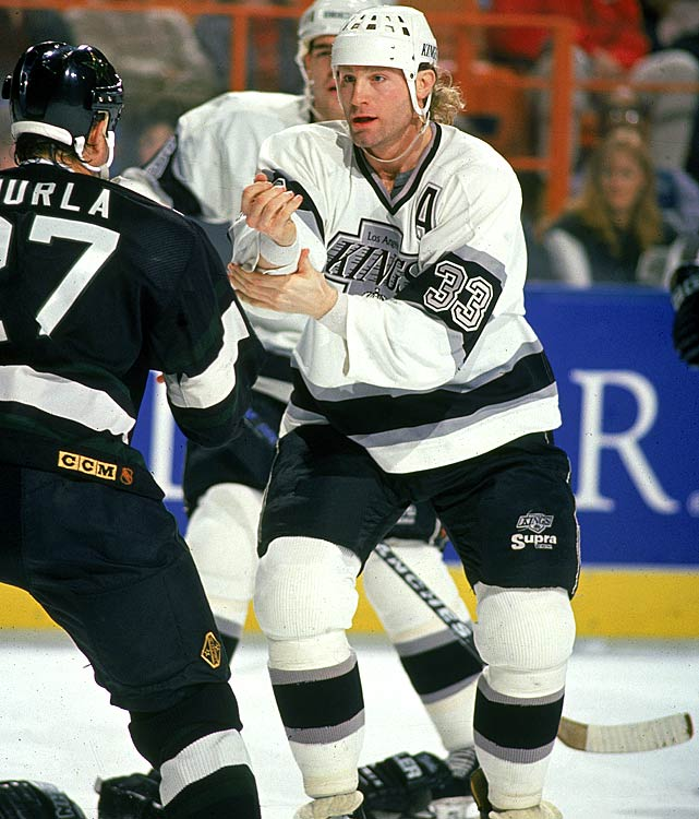 """During his years in Edmonton, McSorley earned the nickname """"Wayne Gretzky's Bodyguard,"""" and so he accompanied the Great One to LA in their famous 1988 trade. McSorley spent seven-plus seasons with the Kings, earning his keep as an enforcer -- as well as inspiring singer/songwriter John Ondrasik to name his band Five For Fighting; leading the NHL with 399 PIM in 1992-93. Unfortunately, he was caught using an illegal stick in Game 2 of the '93 Stanley Cup Final with the Kings up 2-1 with 1:45 to play. The resulting penalty allowed Montreal to tie the game, then the series in OT before taking the next three matches and the Cup."""