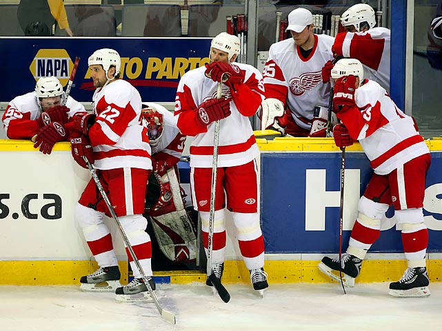 "Top-seeded Detroit ran into a team ready to make a big run. The Red  Wings were first on the Oilers' path to the Stanley Cup finals. In the  clinching Game 6, Edmonton's Ales Hemsky scored with 1:06 left in the  third period to give the Oilers a 4-3 lead. ""I am shocked we're in this  situation,"" Detroit coach Mike Babcock said afterward. Defenseman  Mathieu Schneider put it more bluntly: ""We didn't play like the No. 1  seed."""