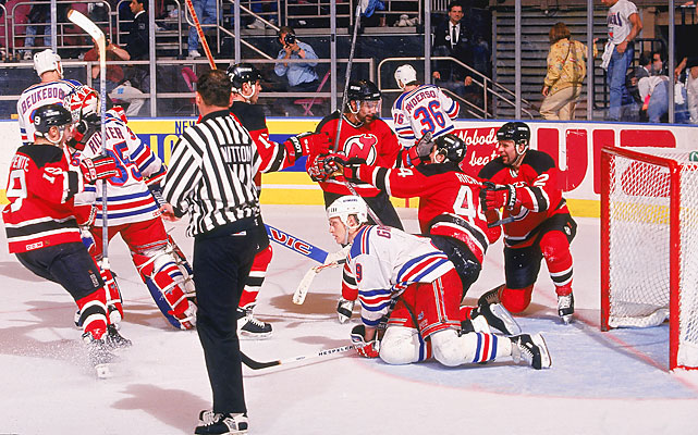 "The Devils stunned the Rangers in the opener. Claude Lemieux scored with 42.7 seconds left in regulation to send it to overtime. After one scoreless overtime, Stephane Richer (44) beat Mike Richter with 4:37 left in the second OT. ""We're usually very good holding leads in the third period, but we let this one get away,"" Rangers defenseman Kevin Lowe told the Associated Press."