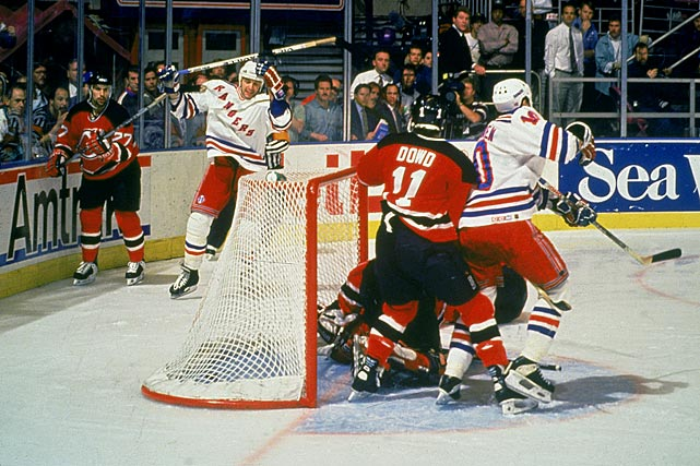 """Matteau, Matteau, Matteau!"" Howie Rose's call of the goal that sent the Rangers to their first Stanley Cup Final since 1979 is still audible to many hockey fans. New York nearly won it in regulation, but Zelepukin tied it with 7.7 seconds left. It set the stage for Matteau's (left) second double-overtime winner of the series, deflecting off Slava Fetisov's stick and past Brodeur. The Rangers would go on to beat the Canucks in seven games for their first championship since 1940."