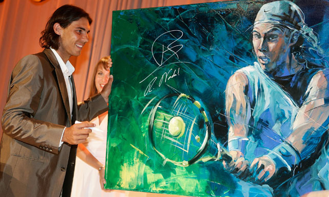 So much color. Nadal signs a portrait at The Laureus Charity Gala in Stuttgart, Germany.
