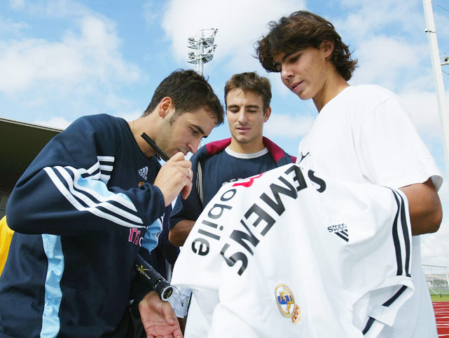 Nadal meets Real Madrid star Raul during the Madrid Masters in 2003.