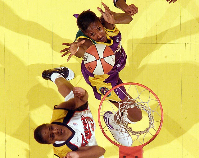 "While Leslie's model looks may have garnered fans' attention, it was her on-court dominance that kept it. She graduated from the University of Southern California in 1994 as the Pac-10's all-time leader in points, rebounds and blocks.  The 6'5"" center headed for the WNBA in 1997, the league's inaugural season. In 2001, Leslie became the first player to win the regular season MVP, the All-Star Game MVP and the playoff MVP as she guided the Los Angeles Sparks to the first of two consecutive titles. In addition to her three MVP trophies, Leslie became the first team sport athlete to win four consecutive Olympic gold medals. She remains the WNBA's all-time leading scorer."