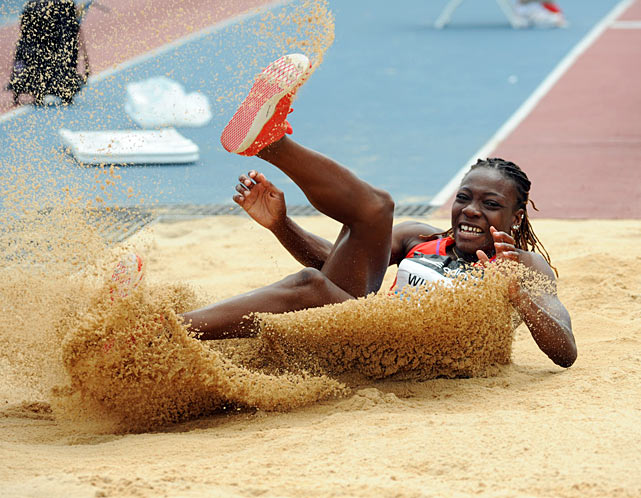 Jamaica's Kimberly Williams becomes one with the sand in the women's triple jump competition. She finished second behind Rypakova.