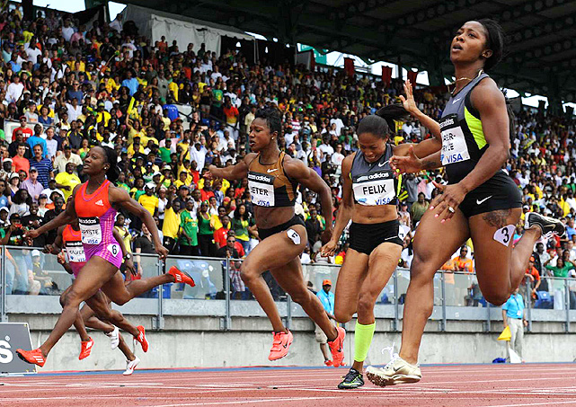 Shelly-Ann Fraser-Price (left) won the women's 100 meters in 10.92 over a strong field including Carmelita Jeter and Allyson Felix, who finished third and fourth, respectively.
