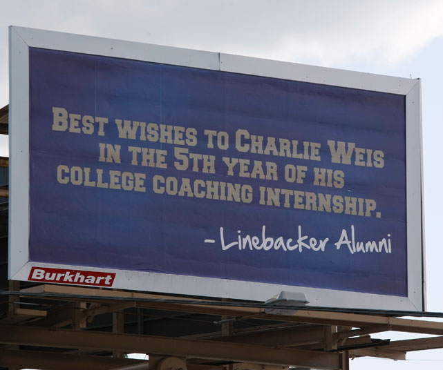 Charlie Weis was 22-6 during his first two seasons at Notre Dame, but then hit a 10-15 skid the next two years. As he entered his fifth season as coach, a group of former players used this billboard to let the coach know the past two seasons had not been good enough.