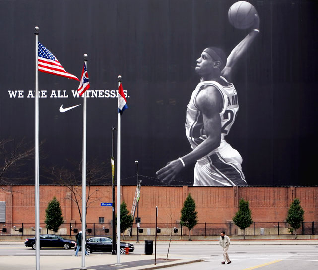 A large Nike banner commemorating LeBron James' sophomore season in the NBA with the Cavaliers hangs on the side of a downtown Cleveland building in November 2005. While James has lived up to the lofty individual expectations of his professional career after skipping college, he never delivered a championship to the Northern Ohio city, which has not had a major professional sports title since 1964.