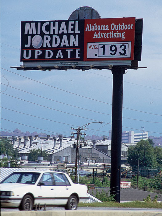 A promotional billboard in Birmingham, Ala. in July 1994 updates motorists on Michael Jordan's batting average during his stint with the local Barons organization, the Double-A affiliate of the Chicago White Sox. Jordan famously stepped away from basketball in 1993 after some personal tragedies, deciding to pursue a professional baseball career in early 1994. Jordan officially retired from baseball on March 10, 1995, returning to an NBA court just 10 days later.