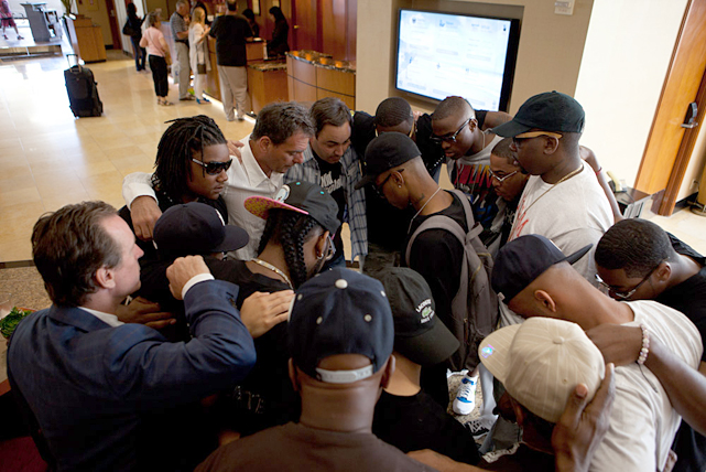 Quillin joins friends and family for a moment of prayer in the hotel lobby before a van arrives to drive the unbeaten middleweight to the Home Depot Center, the Carson, Calif., soccer stadium where the fight is taking place.