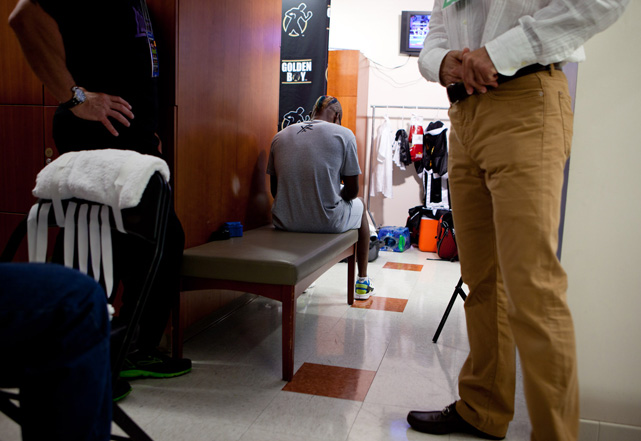 Quillin enjoys a quiet moment in the locker room after getting his hands wrapped.