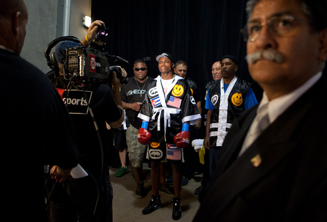 Quillin emerges from the tunnel to make his approach to the ring. Before leaving the dressing room, he dedicates the fight to his father, a Cuban refugee who came to America five years before Peter was born.