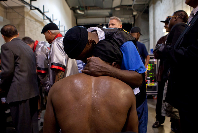 Trainer Eric Brown shares an emotional moment with Quillin in the bowels of the Home Depot Center after the fight.