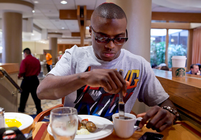 Quillin enjoys coffee with a breakfast of eggs over easy, sausage, potatoes, and a glass of cranberry and orange juice mixed together. The fight is nine hours away.