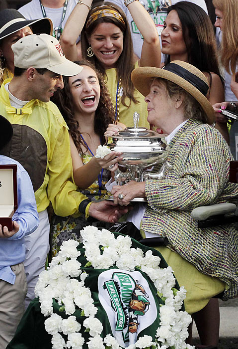 Velasquez and Union Rags owner Phyllis Wyeth (right) hold the winner's trophy after Union Rags won the Belmont Stakes.